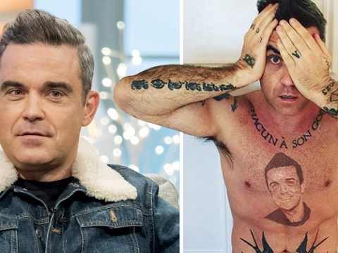 Robbie Williams debuts shocking 'tattoo' of his own face between his nipples and fans aren't having it