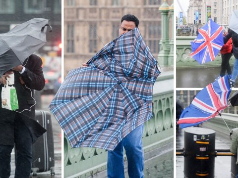 People have been struggling to open their umbrellas in the wind and rain