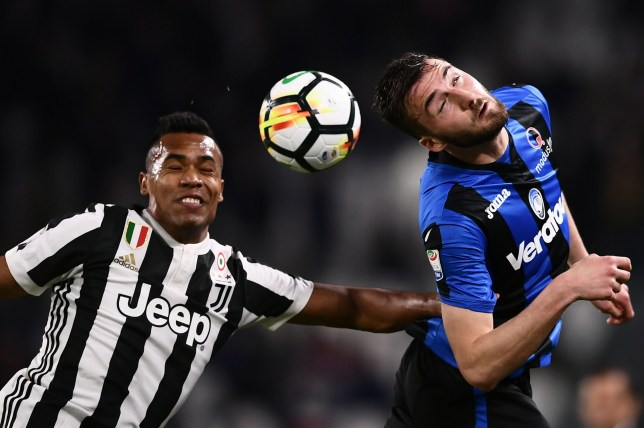 Juventus' Brazilian defender Alex Sandro (L) jumps to head the ball against Atalanta's Italian midfielder Bryan Cristante (R) during the Italian Serie A football match between Juventus and Atalanta on March 14, 2018 at the Allianz Stadium in Turin. / AFP PHOTO / MARCO BERTORELLOMARCO BERTORELLO/AFP/Getty Images