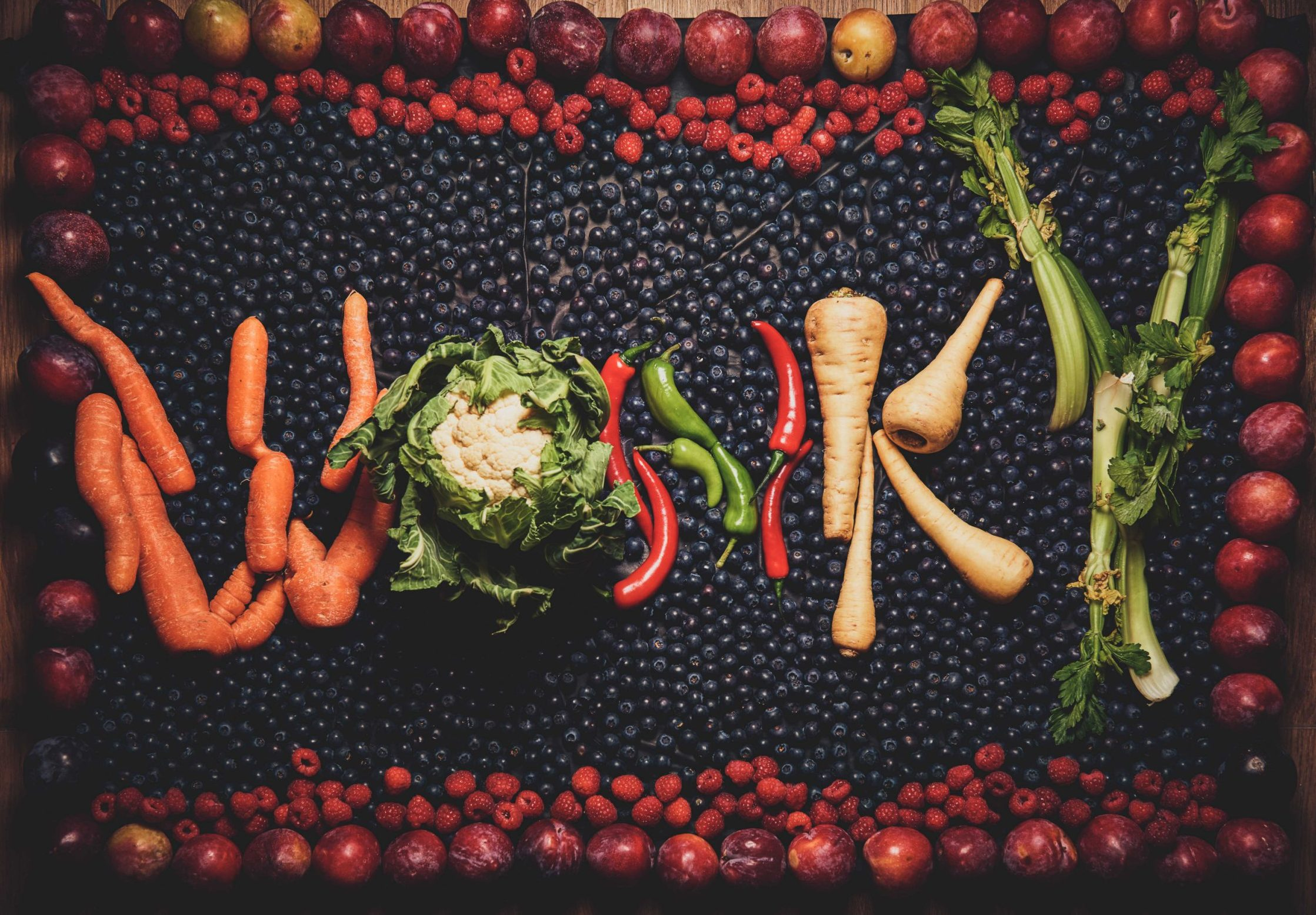 Mandatory Credit: Photo by Mikael Buck/REX/Shutterstock (9501418a) A sign made from wonky fruit and veg Morrisons to increase wonky fruit and veg offerings, UK - 03 Apr 2018 Morrisons is pledging to sell more wonky, over-sized, under-sized and blemished seasonal fruit and veg after listening to customers' continuing concerns about food waste. Wonky fruit and veg occurs for a number of reasons such as poor weather conditions. Products will have been selected from farmers' crops because they are misshapen, have skin blemishes or growth cracks, or are much smaller or larger than average.