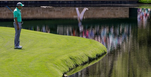 Sergio Garcia, of Spain, looks over the water on the 15th hole during the first round at the Masters golf tournament Thursday, April 5, 2018, in Augusta, Ga. Garcia shot an 8-over 13 on the hole. (AP Photo/David J. Phillip)