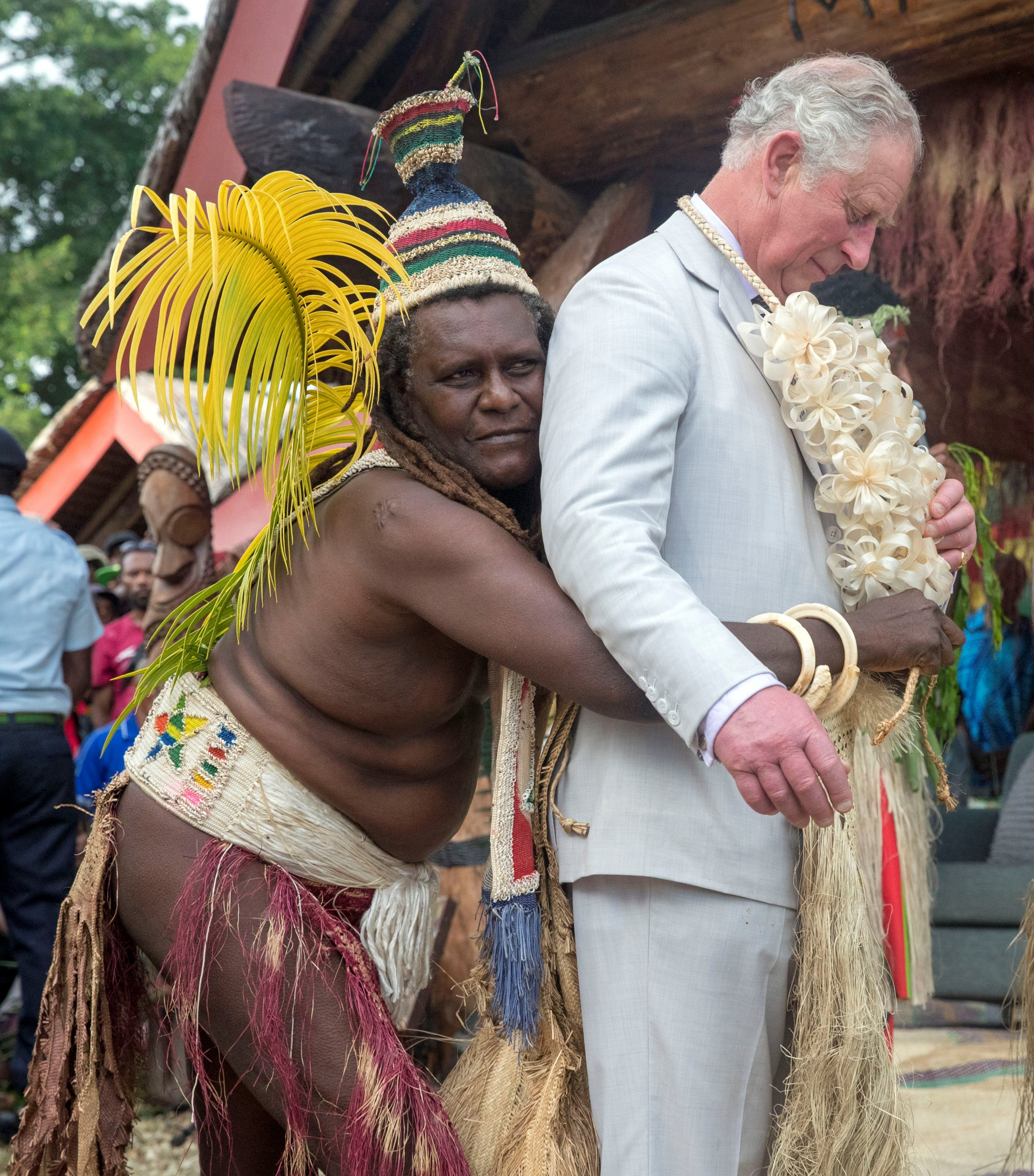 Britain's Prince Charles is given a grass skirt to wear prior to receiving a chiefly title during a visit to the Chiefs' nakamal, as he visits the South Pacific island of Vanuatu, April 7, 2018. Steve Parsons/Pool via Reuters