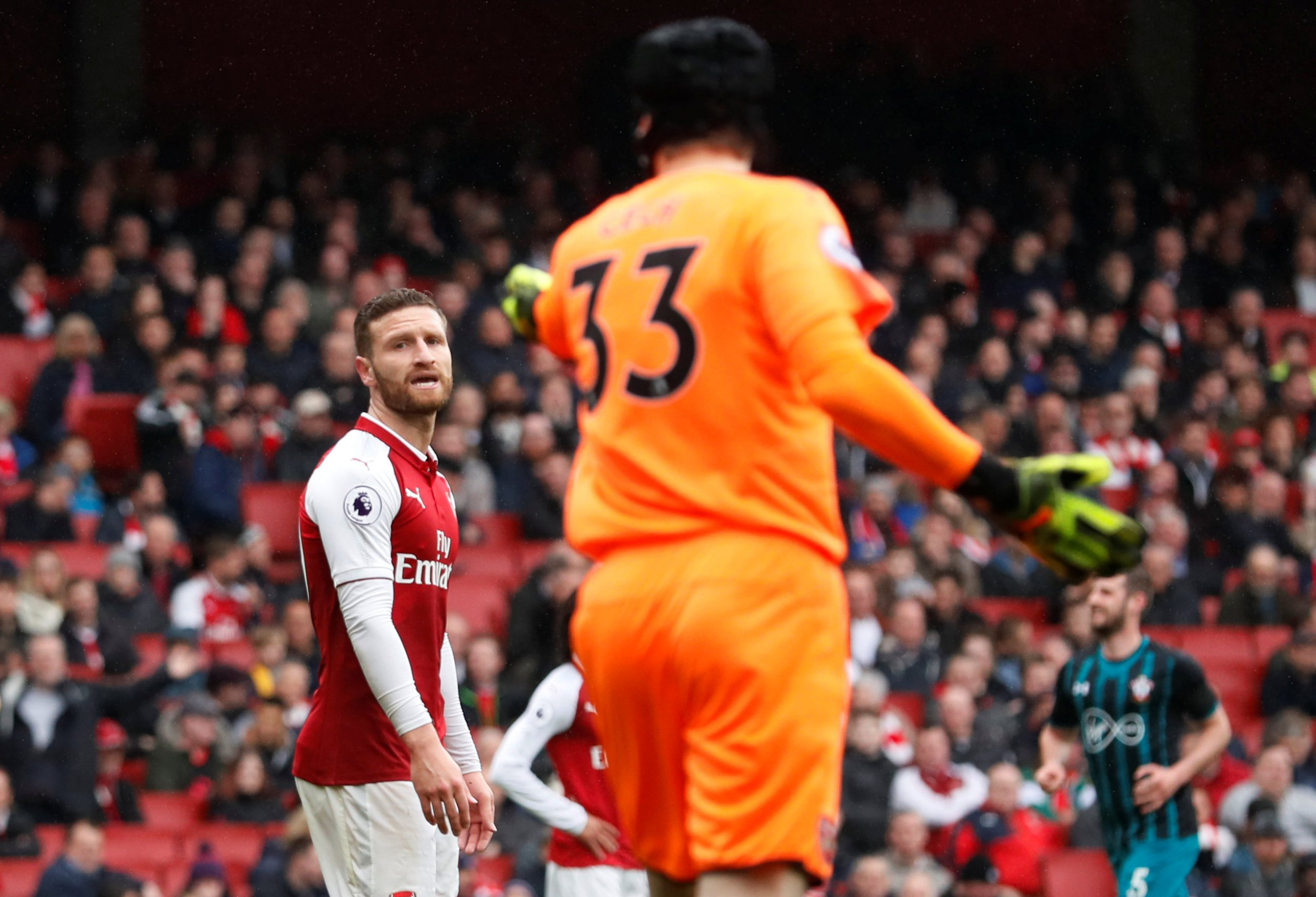 """Soccer Football - Premier League - Arsenal vs Southampton - Emirates Stadium, London, Britain - April 8, 2018 Arsenal's Shkodran Mustafi and Petr Cech react after Southampton's Shane Long scores their first goal REUTERS/David Klein EDITORIAL USE ONLY. No use with unauthorized audio, video, data, fixture lists, club/league logos or """"live"""" services. Online in-match use limited to 75 images, no video emulation. No use in betting, games or single club/league/player publications. Please contact your account representative for further details."""