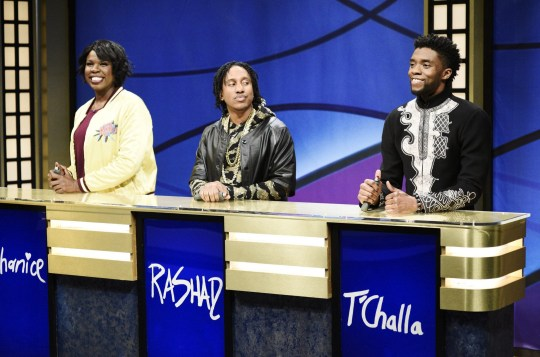 """SATURDAY NIGHT LIVE -- Episode 1742 """"Chadwick Boseman"""" -- Pictured: (l-r) Leslie Jones as Shanice, Chris Redd as Rashad, Chadwick Boseman as T'Challa during 'Black Jeopardy' in Studio 8H on Saturday, April 7, 2018 -- (Photo by: Will Heath/NBC/NBCU Photo Bank via Getty Images)"""