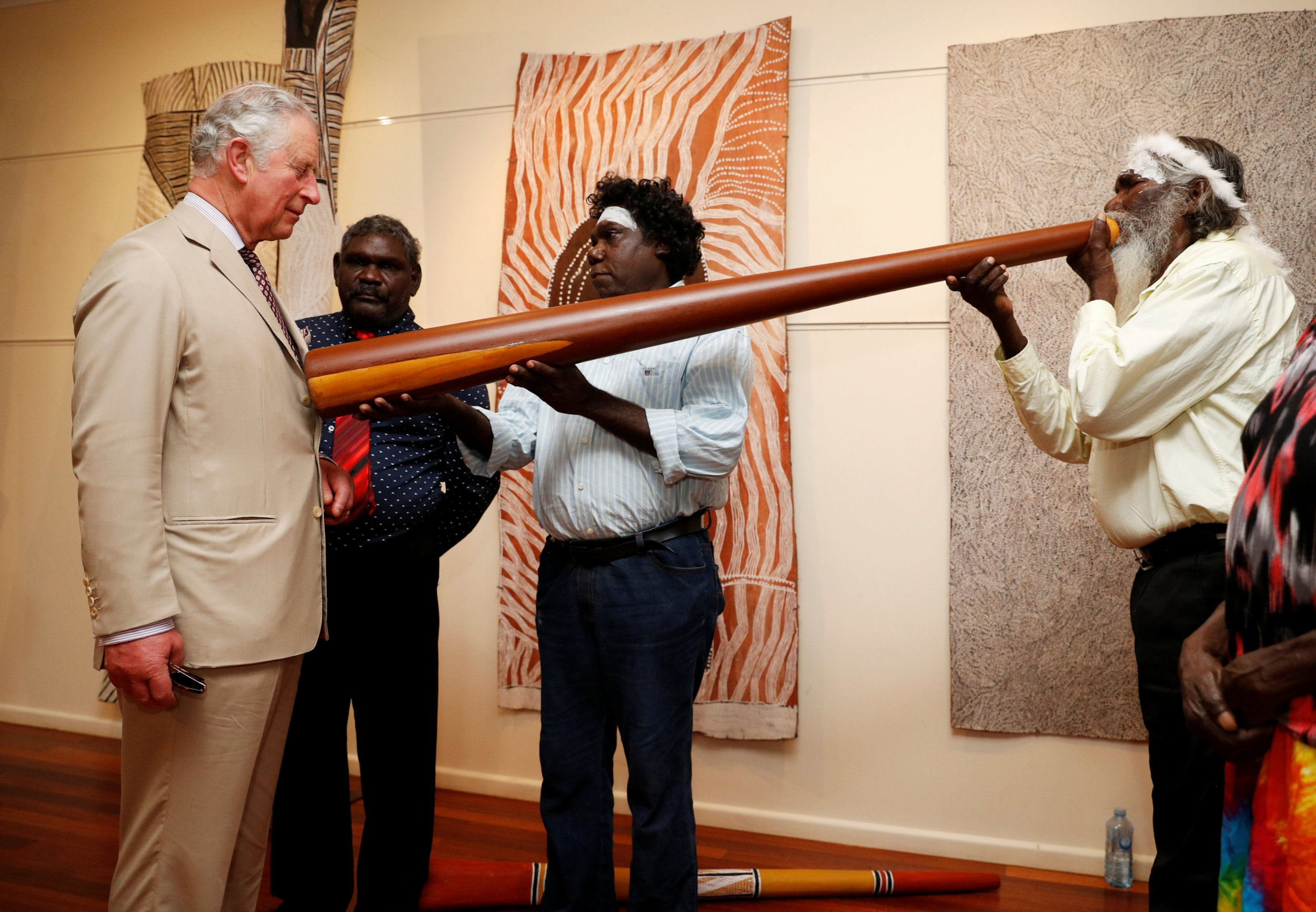 The Prince of Wales takes part in a didgeridoo demonstration during a visit to the Buku-Larrnggay Mulka Centre in Yirrkala, in Australia's Northern Territory. PRESS ASSOCIATION Photo. Picture date: Monday April 9, 2018. See PA story ROYAL Tour. Photo credit should read: Phil Noble/PA Wire