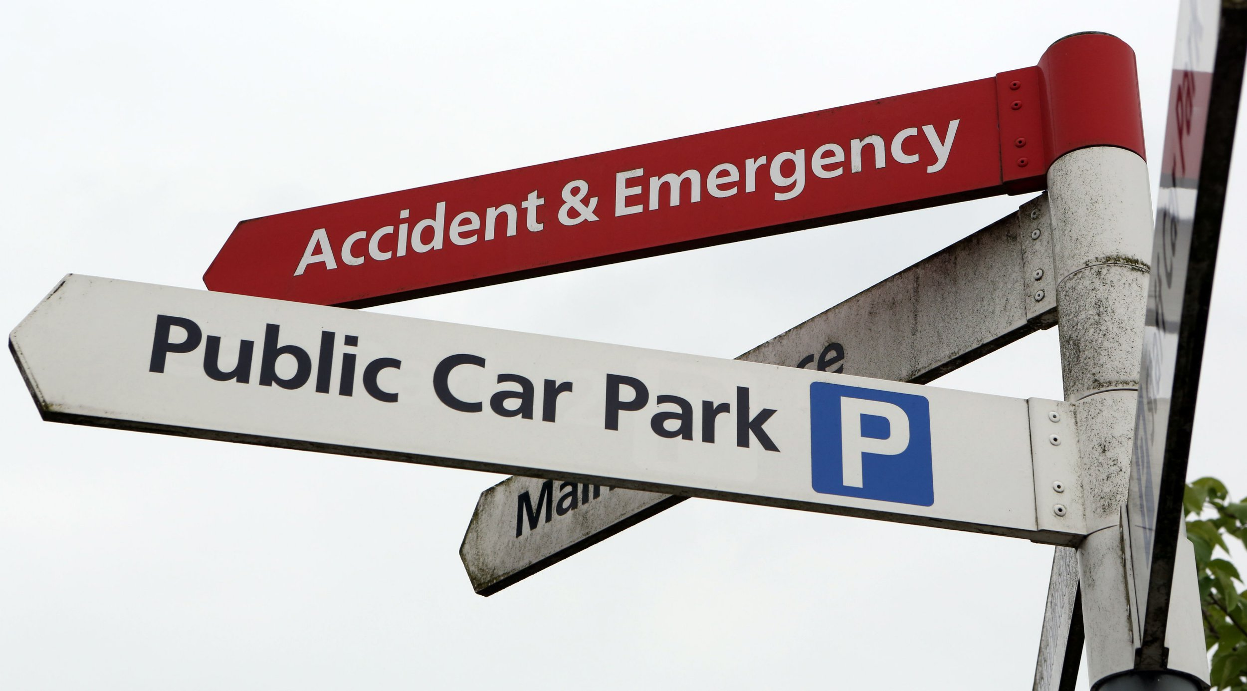 Embargoed to 0001 Monday April 09 File photo dated 21/05/13 of accident and emergency and public car park signs at a hospital. Three out of 10 hospitals charge staff for car parking, new figures show.