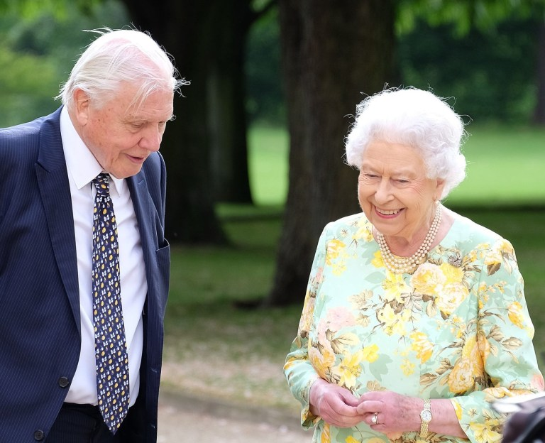 "Embargoed to 0001 Tuesday April 10 Undated ITV handout photo of Queen Elizabeth II and Sir David Attenborough in the gardens of Buckingham Palace during filming of a landmark documentary. The Queen has poked fun at the noisy aircraft favoured by US President Donald Trump and his predecessor Barack Obama during a documentary celebrating a Commonwealth environmental project. PRESS ASSOCIATION Photo. Issue date: Tuesday April 10, 2018. Chatting to Sir David Attenborough as they stroll through Buckingham Palace's gardens the Queen says ""sounds like President Trump, or President Obama"", when the peaceful setting is shattered by the sound of an aircraft. See PA story ROYAL Commonwealth. Photo credit should read: ITV/PA Wire NOTE TO EDITORS: This handout photo may only be used in for editorial reporting purposes for the contemporaneous illustration of events, things or the people in the image or facts mentioned in the caption. Reuse of the picture may require further permission from the copyright holder."