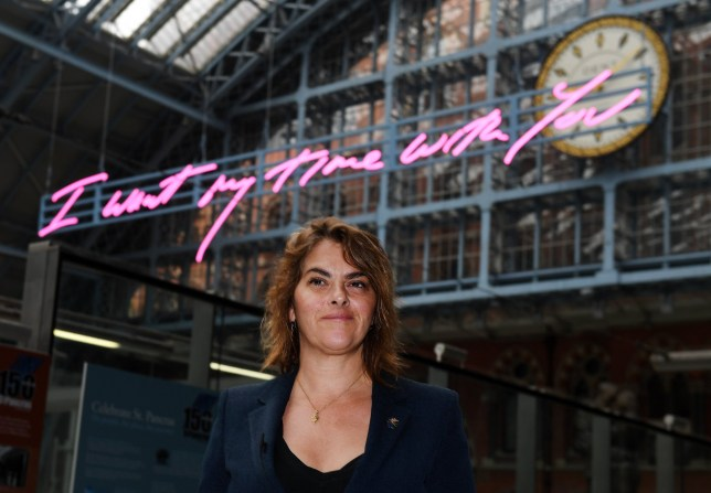 epa06658570 British artist Tracey Emin unveils her new art installation at Kings Cross St Pancras station in London, Britain, 10 April 2018. Depicting the words 'I Want My Time With You' in Emin's signature handwriting, the LED light installation is the largest text artwork ever made by the artist and will remain in the station until the end of 2018. EPA/ANDY RAIN