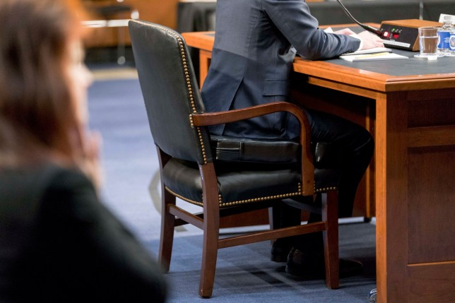 Facebook CEO Mark Zuckerberg sits on a cushion as he testifies before a joint hearing of the Commerce and Judiciary Committees on Capitol Hill in Washington, Tuesday, April 10, 2018, about the use of Facebook data to target American voters in the 2016 election. (AP Photo/Andrew Harnik)