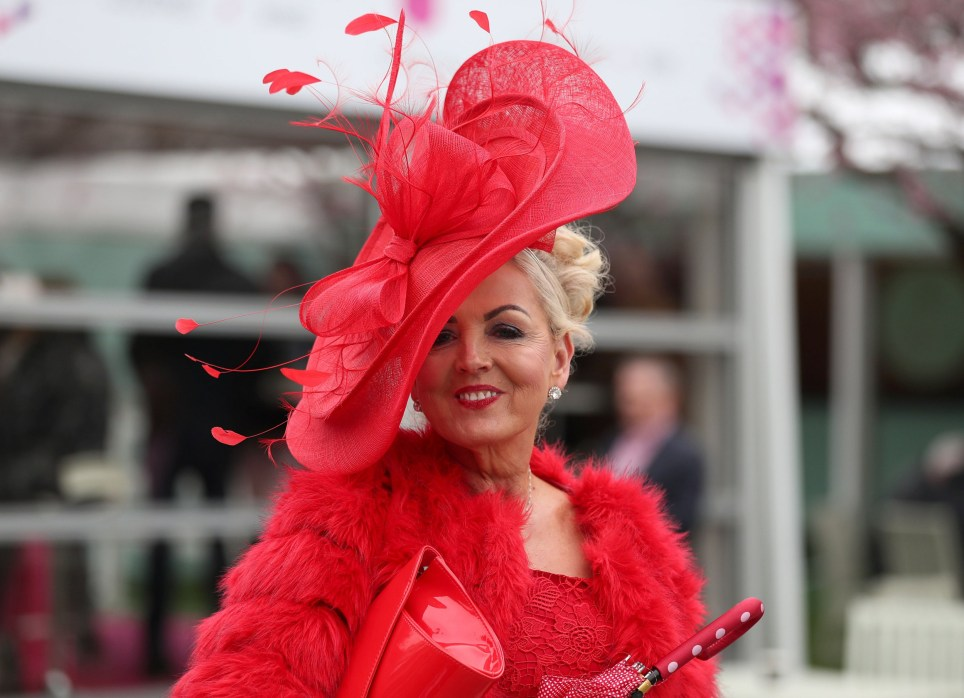 Racegoers arriving during day one of the 2018 Randox Health Grand National Festival at Aintree Racecourse, Liverpool. PRESS ASSOCIATION Photo. Picture date: Thursday April 12, 2018. See PA story RACING Aintree. Photo credit should read: David Davies/PA Wire