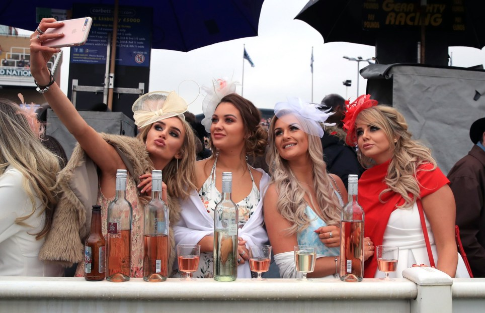 Female racegoers trackside during Ladies Day of the 2018 Randox Health Grand National Festival at Aintree Racecourse, Liverpool. PRESS ASSOCIATION Photo. Picture date: Friday April 13, 2018. See PA story RACING Aintree. Photo credit should read: Peter Byrne/PA Wire