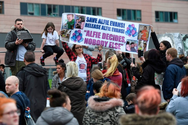 Supporters of seriously ill British toddler being kept alive on a ventilator Alfie Evans demonstrate outside Alder Hey Children's Hospital in Liverpool, northwest England, on April 16, 2018 as Court of Appeal judges hear an appeal against a decision to allow doctors at the hospital to stop treating the toddler on the basis that he can't be saved. Alfie Evans, who is 22 months old, has a rare degenerative neurological condition which has not been definitively diagnosed. His parents, Tom Evans and Kate James, have fought a legal battle to stop the Alder Hey Children's Hospital in Liverpool, northwest England, from turning off his ventilator -- which would quickly end his life. Doctors at Alder Hey have said life-support treatment should stop because further treatment was futile. This was accepted by Britain's High Court and upheld in the Court of Appeal and then in the Supreme Court -- the ultimate court in Britain. / AFP PHOTO / Paul ELLISPAUL ELLIS/AFP/Getty Images