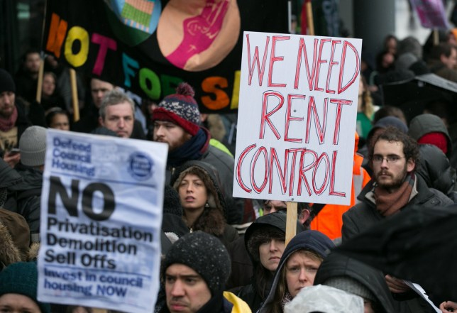 Focus E15 campaigners holding placards during a demonstration demanding solutions to the housing crisis in London at City Hall, London.