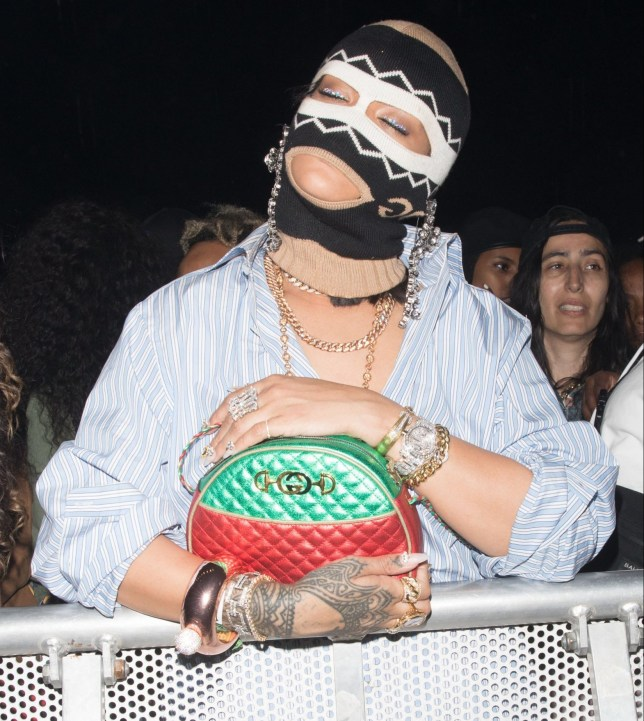 EXCLUSIVE: Rihanna is seen in a mask during the Migos Performance at Coachella Pictured: Rihanna Ref: SPL1683110 160418 EXCLUSIVE Picture by: Mr.Canon / Splash News Splash News and Pictures Los Angeles: 310-821-2666 New York: 212-619-2666 London: 870-934-2666 photodesk@splashnews.com