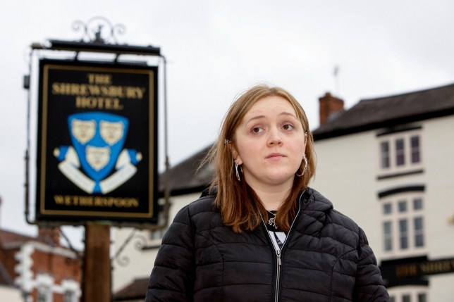 Grace Currie outside The Shrewsbury Hotel, April 17, 2018. A disabled woman with a speech impediment was thrown out of a Wetherspoons pub because managers thought she was drunk. See NTI story NTIPUB. Grace Currie, 24, was ordered to leave when she tried to order a vodka and coke while enjoying a night out with friends. Despite trying to explain that she had suffered a brain injury which caused her to slur her words, a bouncer frogmarched her out the pub. Grace almost died when she was mown down by a car in September 2010 which left her in a coma for six weeks and suffering catastrophic head injuries. The talented photographer was booted out The Shrewsbury Hotel in the Shropshire town after meeting up with friends on Saturday (14/4) night. Shockingly, Grace was kicked out without being allowed to collect her phone and coat meaning she was left outside with no way of contacting anyone. It took several minutes until Grace???s personal carer, Netty Brook, who was in the pub with her, realised what had happened and came to her aid. Grace, of Bagley, Shrops., went home in tears and told her parents, Graeme and Lorraine, both 61, what had happened and they complained to the pub manager.