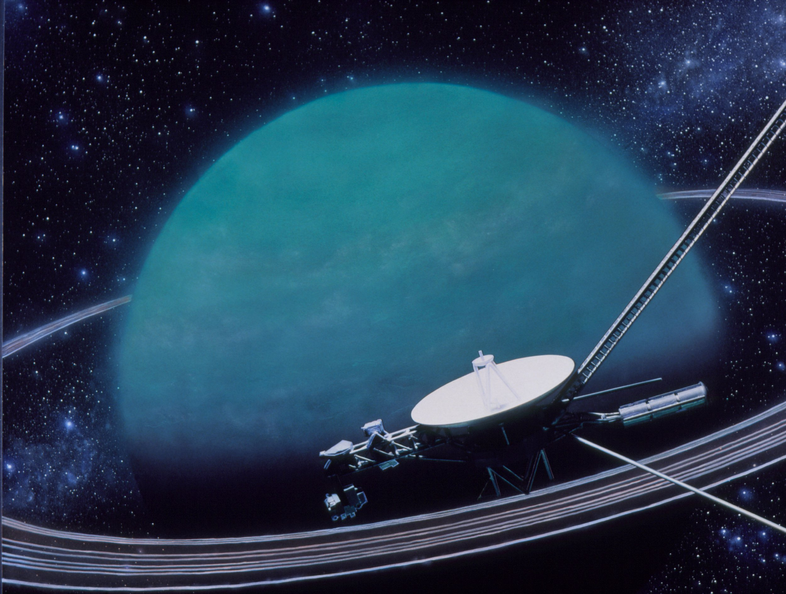 This artwork, by Julian Baum, shows the Voyager 2 spaceprobe only minutes away from closest approach to the planet Uranus, on 24/Jan/86. Uranus is one of the four great gas giants. It is unique in that its equator, along with its moons and tenuous ring system, is tilted at 98 degrees to the plane of the Solar System. Because of this, Voyagers encounter with the planet and its satellites lasted only about six hours. It also means that in alternate seasons Uranus poles and equator in turn face the Sun. Uranus orbits the Sun once in 84 years and, at present, the planets south pole faces the Sun, in the midst of a 21 year long summer.
