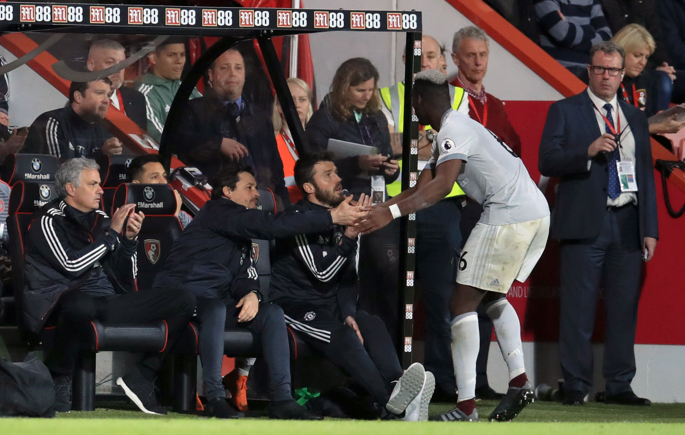 "Manchester United's Paul Pogba (right) shakes hands with assistant manager Rui Faria and coach Michael Carrick as he is substituted whilst manager Jose Mourinho (left) looks on during the Premier League match at the Vitality Stadium, Bournemouth. PRESS ASSOCIATION Photo. Picture date: Wednesday April 18, 2018. See PA story SOCCER Bournemouth. Photo credit should read: Adam Davy/PA Wire. RESTRICTIONS: EDITORIAL USE ONLY No use with unauthorised audio, video, data, fixture lists, club/league logos or ""live"" services. Online in-match use limited to 75 images, no video emulation. No use in betting, games or single club/league/player publications."