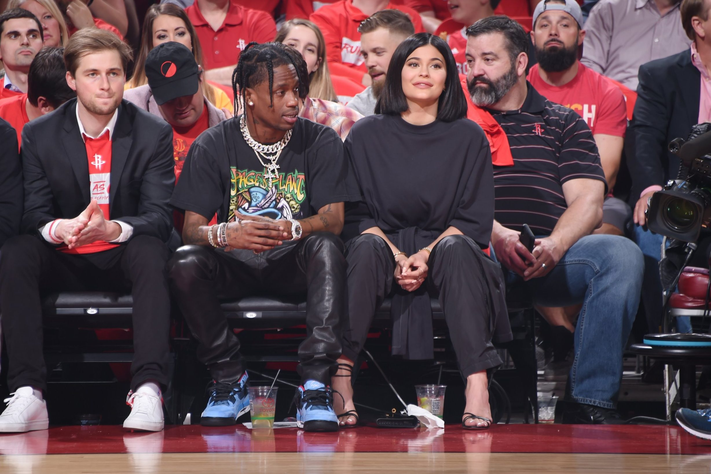 HOUSTON, TX - APRIL 18: Travis Scott and Kylie Jenner attend the game as the Minnesota Timberwolves take on the Houston Rockets during Game Two of Round One of the 2018 NBA Playoffs on April 18, 2018 at the Toyota Center in Houston, Texas. NOTE TO USER: User expressly acknowledges and agrees that, by downloading and or using this photograph, User is consenting to the terms and conditions of the Getty Images License Agreement. Mandatory Copyright Notice: Copyright 2018 NBAE (Photo by Bill Baptist/NBAE via Getty Images)