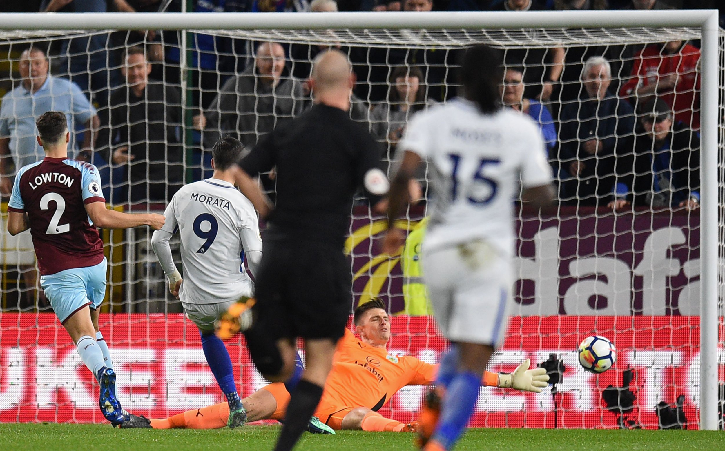 Chelsea's Spanish striker Alvaro Morata (2nd L) shoots wide during the English Premier League football match between Burnley and Chelsea at Turf Moor in Burnley, north west England on April 19, 2018. / AFP PHOTO / Oli SCARFF / RESTRICTED TO EDITORIAL USE. No use with unauthorized audio, video, data, fixture lists, club/league logos or 'live' services. Online in-match use limited to 75 images, no video emulation. No use in betting, games or single club/league/player publications. / OLI SCARFF/AFP/Getty Images