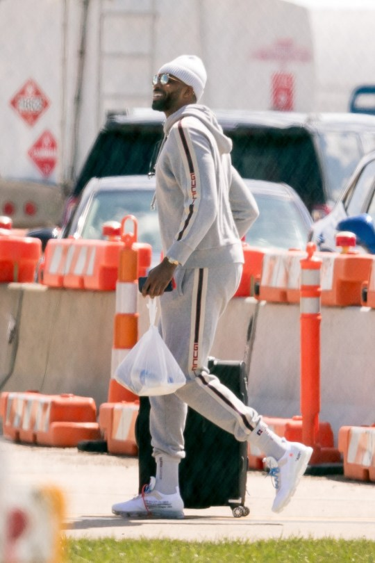 Cleveland, OH - *EXCLUSIVE* - Tristan Thompson leaves Cleveland for the next game with his team the Cleveland Cavaliers amid a cheating controversy. Tristan looks casual as he wears a knit beanie and a matching sweater and track pants for the occasion. Pictured: Tristan Thompson BACKGRID USA 19 APRIL 2018 USA: +1 310 798 9111 / usasales@backgrid.com UK: +44 208 344 2007 / uksales@backgrid.com *UK Clients - Pictures Containing Children Please Pixelate Face Prior To Publication*