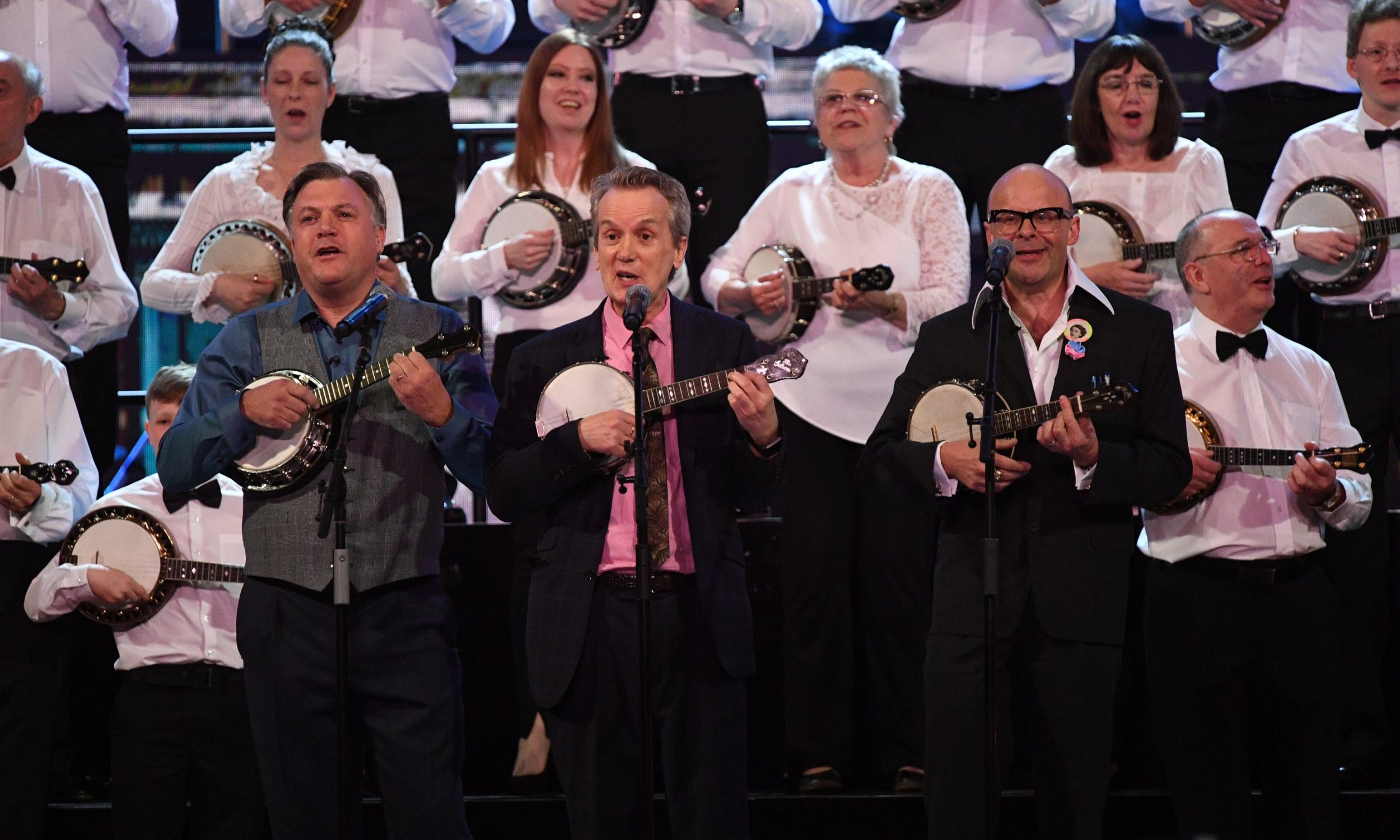 LONDON, ENGLAND - APRIL 21: The George Formby Society featuring Frank Skinner, Harry Hill and Ed Balls perform at the Royal Albert Hall for a star-studded concert to celebrate the Queen's 92nd birthday on April 21, 2018 in London, England. The Queen and members of the royal family are guests of honour at the celebration, which is being billed as The Queen's Birthday Party. (Photo by Andrew Parsons - WPA Pool/Getty Images)