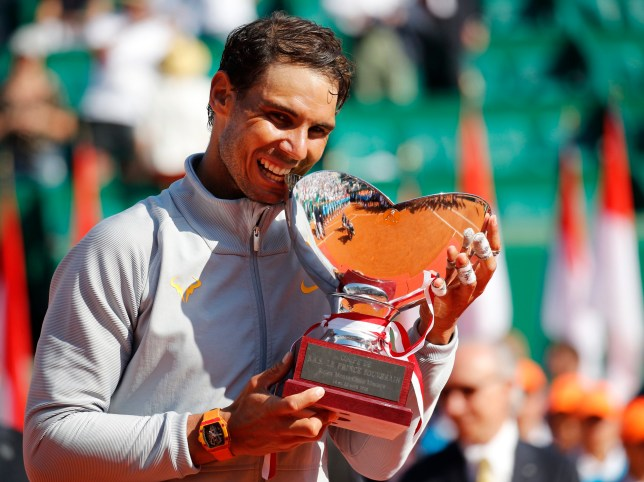 Spain's Rafael Nadal holds the trophy as he celebrates winning the men's singles final match of the Monte Carlo Tennis Masters tournament against Japan's Kei Nishikori in two sets, 6-3, 6-2, in Monaco, Sunday April 22, 2018. (AP Photo/Christophe Ena)