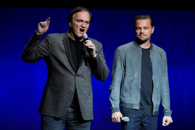 """Quentin Tarantino, left, writer/director of the upcoming film """"Once Upon a Time in Hollywood,"""" discusses the project as cast member Leonardo DiCaprio looks on during the Sony Pictures Entertainment presentation at CinemaCon 2018, the official convention of the National Association of Theatre Owners, at Caesars Palace on Monday, April 23, 2018, in Las Vegas. (Photo by Chris Pizzello/Invision/AP)"""