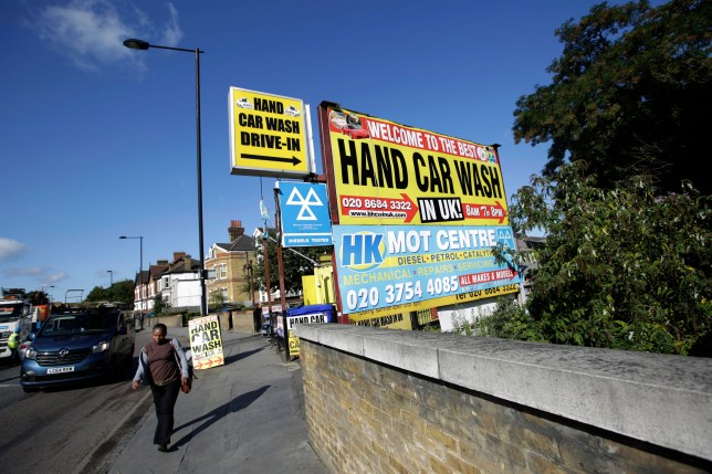 Signs advertise a hand car wash in the Thornton Heath neighbourhood of London, U.K., on Friday, Aug. 28, 2015. The fastest-rising neighborhood in London's property market isn't posh Knightsbridge or hip Shoreditch, it's Thornton Heath, an unglamorous suburb of commuter-town Croydon that's almost nine miles (14 kilometers) from Buckingham Palace. Photographer: Matthew Lloyd/Bloomberg via Getty Images