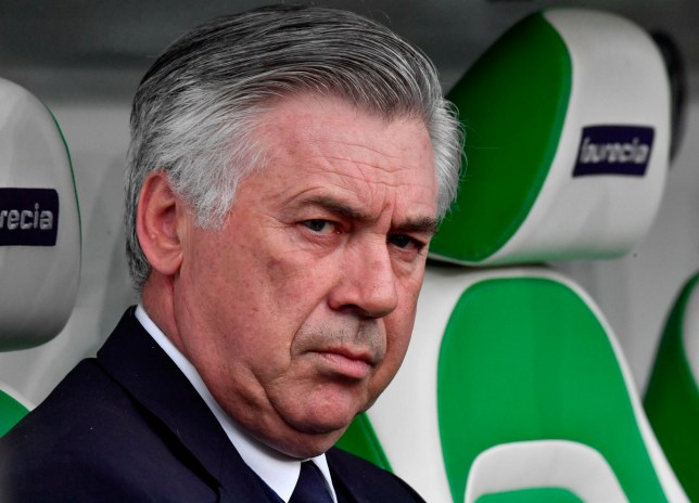 (FILES) In this file photo taken on April 29, 2017 then Bayern Munich's Italian head coach Carlo Ancelotti looks on prior to the German first division Bundesliga football match between VfL Wolfsburg and Bayern Munich in Wolfsburg, northern Germany. Carlo Ancelotti is set to be given the job of reviving the fortunes of Italy's national team, according to reports on April 24, 2018. Ancelotti, who was sacked by Bayern Munich last September, met with Italian Football Federation (FIGC) commissioner Roberto Fabbricini and sub-commissioner Alessandro Costacurta in a Rome hotel on April 23, Corriere dello Sport reported. / AFP PHOTO / John MACDOUGALL / RESTRICTIONS: DURING MATCH TIME: DFL RULES TO LIMIT THE ONLINE USAGE TO 15 PICTURES PER MATCH AND FORBID IMAGE SEQUENCES TO SIMULATE VIDEO. == RESTRICTED TO EDITORIAL USE == FOR FURTHER QUERIES PLEASE CONTACT DFL DIRECTLY AT + 49 69 650050 JOHN MACDOUGALL/AFP/Getty Images