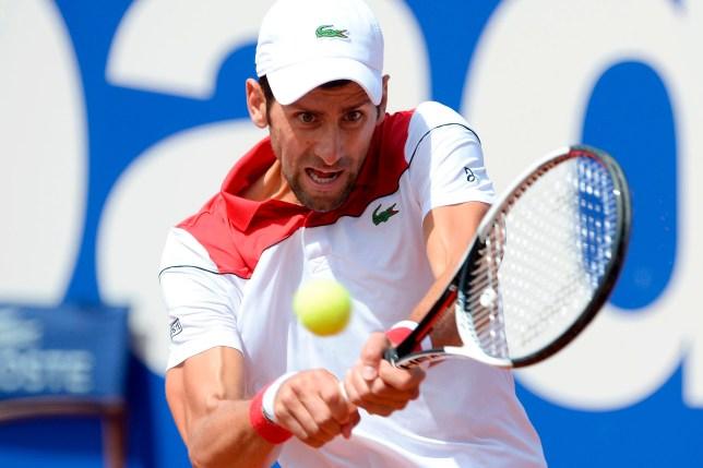 Serbia's Novak Djokovic returns the ball to Slovakia's Martin Klizan during their Barcelona Open ATP tournament tennis match in Barcelona on April 25, 2018. / AFP PHOTO / Josep LAGOJOSEP LAGO/AFP/Getty Images