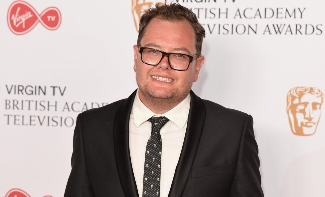 LONDON, ENGLAND - MAY 14: Alan Carr poses in the Winner's room at the Virgin TV BAFTA Television Awards at The Royal Festival Hall on May 14, 2017 in London, England. (Photo by Jeff Spicer/Getty Images)