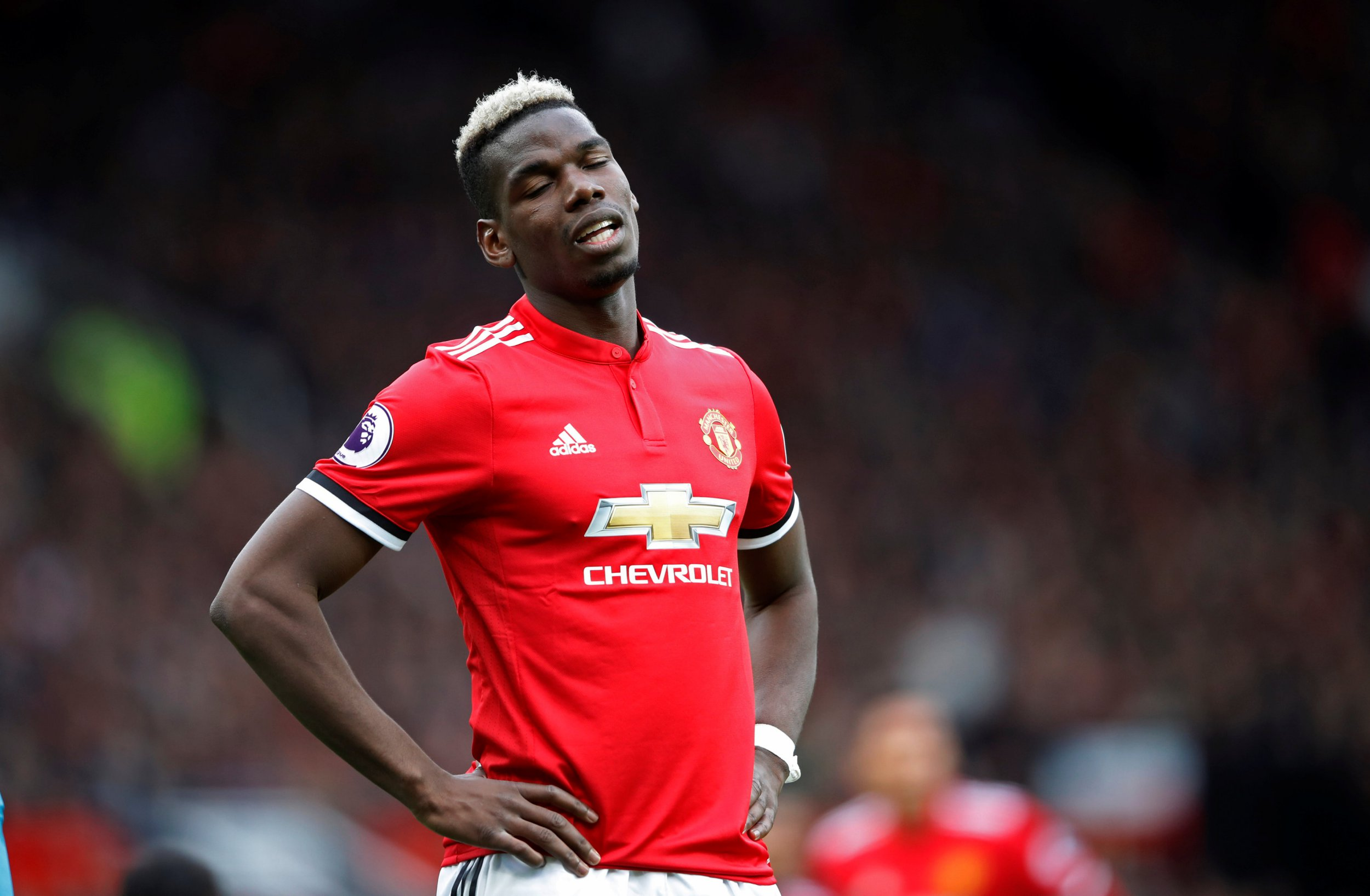 """Soccer Football - Premier League - Manchester United v Arsenal - Old Trafford, Manchester, Britain - April 29, 2018 Manchester United's Paul Pogba reacts Action Images via Reuters/Carl Recine EDITORIAL USE ONLY. No use with unauthorized audio, video, data, fixture lists, club/league logos or """"live"""" services. Online in-match use limited to 75 images, no video emulation. No use in betting, games or single club/league/player publications. Please contact your account representative for further details."""