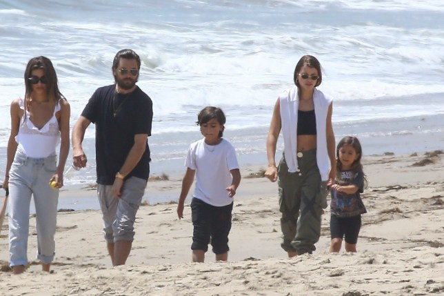 Malibu, CA - *EXCLUSIVE* - Scott Disick enjoys a stroll on the beach with Sofia Richie and his kids. The group look happy as they make their way down the picturesque beach. Pictured: Scott Disick, Sofia Richie, Penelope Scotland Disick, Mason Dash Disick BACKGRID USA 29 APRIL 2018 USA: +1 310 798 9111 / usasales@backgrid.com UK: +44 208 344 2007 / uksales@backgrid.com *UK Clients - Pictures Containing Children Please Pixelate Face Prior To Publication*