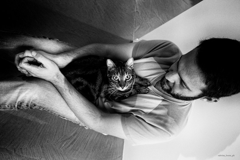 Sabrina Boem's photo series of men with their cats