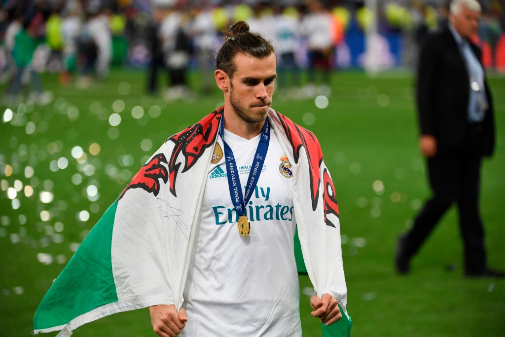 Gareth Bale with Wales flag after Real Madrid Champions League win.