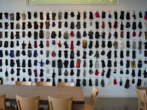 This company displays lost gloves on a wall and it's the cutest
