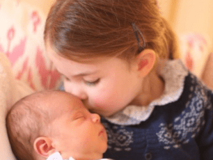 Princess Charlotte kisses baby brother Prince Louis on the head in adorable first photos