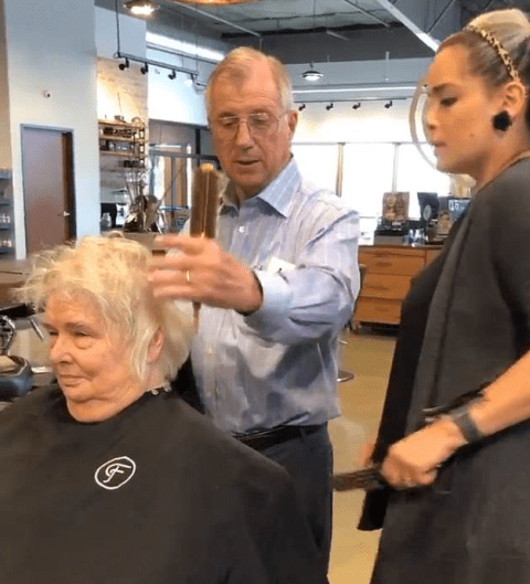 Elderly husband learns how to style his wife's hair after she had a stroke