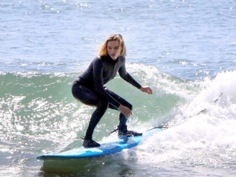 Margot Robbie has finally mastered the art of surfing as she takes to the board in Miami – without falling off