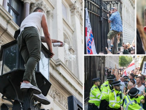 Tommy Robinson supporter empties can of Stella on top of Downing Street gates