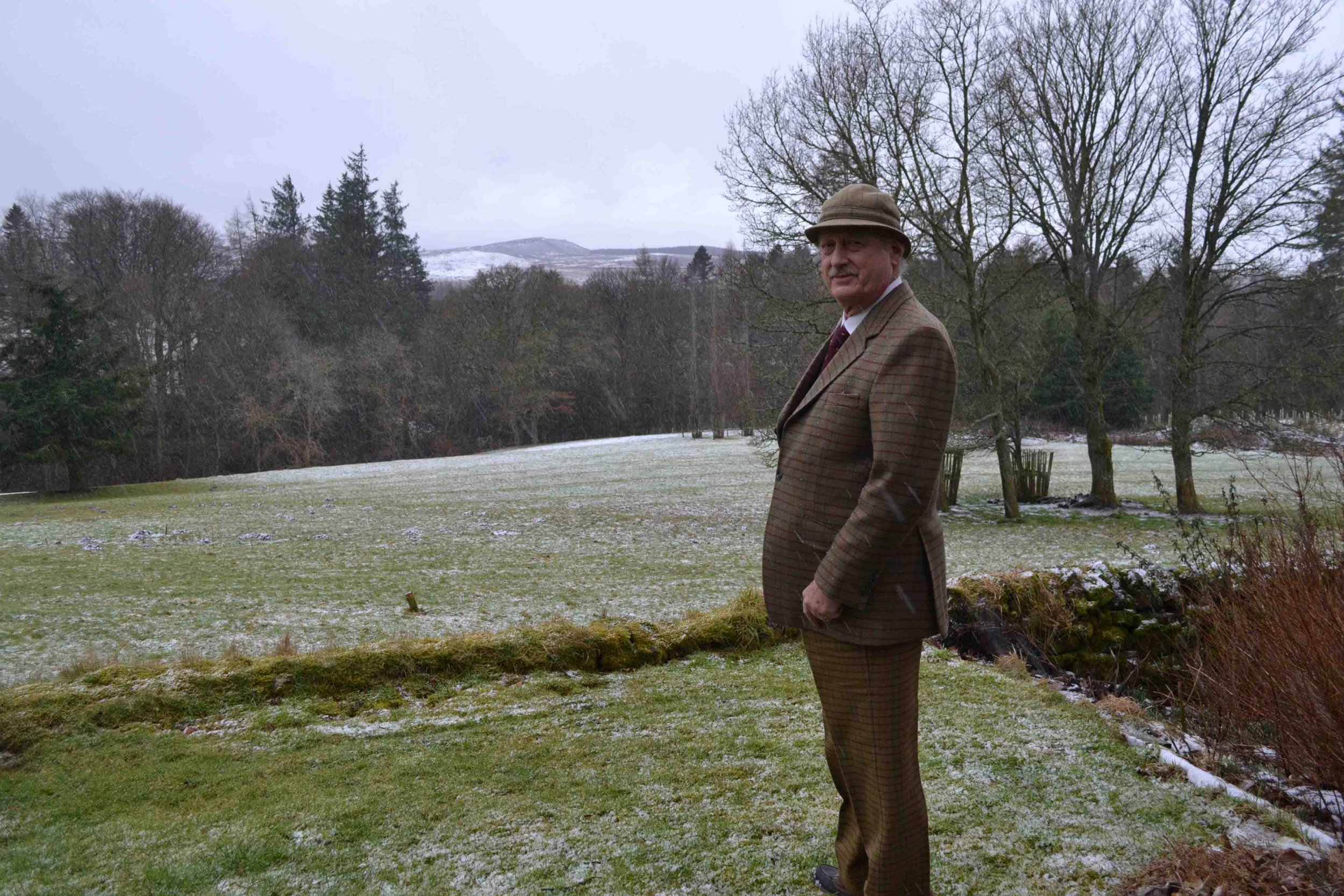 A landowner wants to honour the Queen by erecting a towering sculpture three times the height of The Angel of the North. Viscount Devonport hopes his proposed Elizabeth Landmark will boost tourism in some of the nearby rural communities. Three artists were invited to submit proposals for the site on top of a hill called Cold Law on his Ray Demesne estate, which lies between the A68 and the A696 at Kirkwhelpington. Curator Matthew Jarrett, who helped to select the artists, said the proposed sculpture would stand 60m high (Gateshead?s Angel is 20m high) and, from its elevated position, be equal in height to the prominent Great Wanney Crag on the estate. Viscount Devonport in his garden with the site of the proposed sculpture beyond the trees