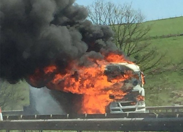 (Picture: @adnan_megatron)Traffic is currently held on the #M62 in both directions between J22 and J21 due to an HGV fire. Emergency services en route. We'll keep you updated. Latest picture from scene: