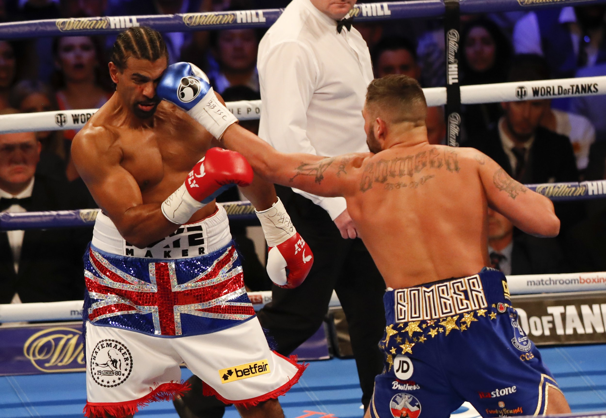 Britain's Tony Bellew, right, sends a left to his countryman David Haye during the boxing heavyweight rematch bout between Tony Bellew and David Haye at the O2 Arena in London, Saturday, May 5, 2018. (AP Photo/Frank Augstein)
