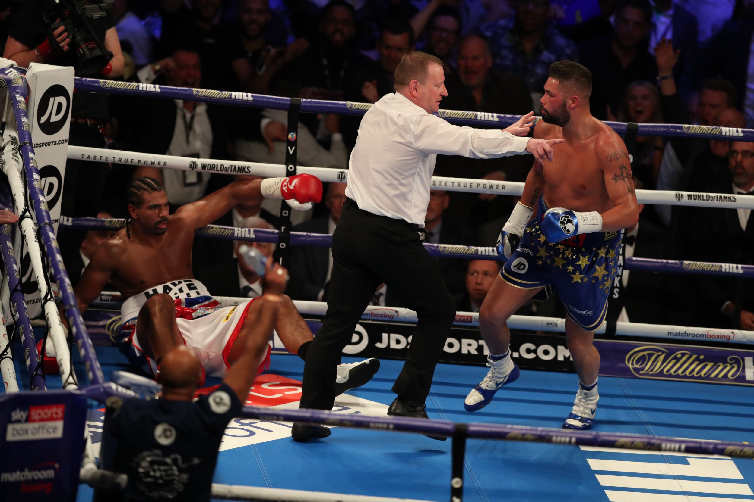 TOPSHOT - British boxer David Haye (L) sits on the canvas as boxer Tony Bellew is sent to his corner during their heavyweight rematch at the O2 Arena in London on May 5, 2018. / AFP PHOTO / Daniel LEAL-OLIVASDANIEL LEAL-OLIVAS/AFP/Getty Images