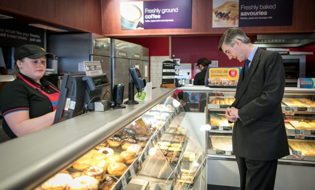 KEYNSHAM, UNITED KINGDOM - MAY 04: Conservative MP Jacob Rees-Mogg stops to buy a sandwich as he walks along the main street near his constituency office in Keynsham on May 4, 2018 in North East Somerset, United Kingdom. In a recent interview, the pro-Brexit leader of the European Research Group, had hit back at his critics who have claimed he was to Brexit negotiations 'what Russia is to the UN's Security Council' and instead insisted he was acting to help deliver the EU referendum result and that the ERG were simply encouraging the government to keep its promises. (Photo by Matt Cardy/Getty Images)