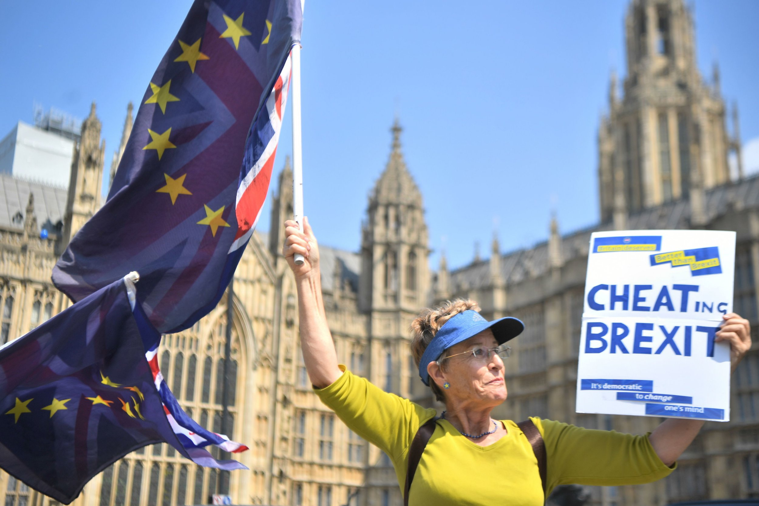 "An activist waves European Union and Union flags outside the Houses of Parliament in Westminster, London. PRESS ASSOCIATION Photo. Picture date: Tuesday May 8, 2018. Theresa May will be forced to abandon proposals for a ""customs partnership"" with the EU, a leading Conservative Brexiteer has warned. See PA story POLITICS Brexit. Photo credit should read: Victoria Jones/PA Wire"