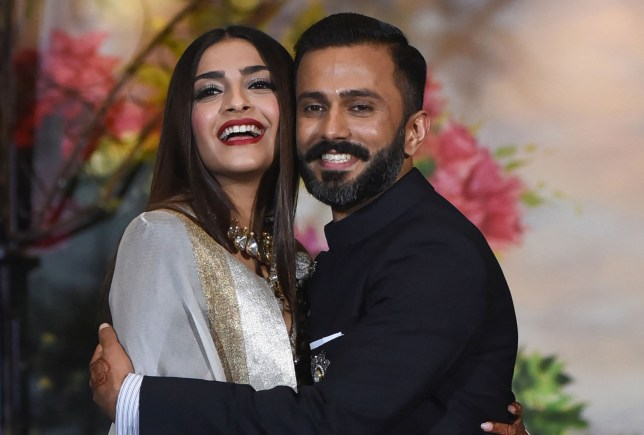 Indian Bollywood actress Sonam Kapoor poses with her husband, businessman Anand Ahuja after their traditional marriage ceremony in Mumbai on May 8, 2018. / AFP PHOTO / Sujit JaiswalSUJIT JAISWAL/AFP/Getty Images