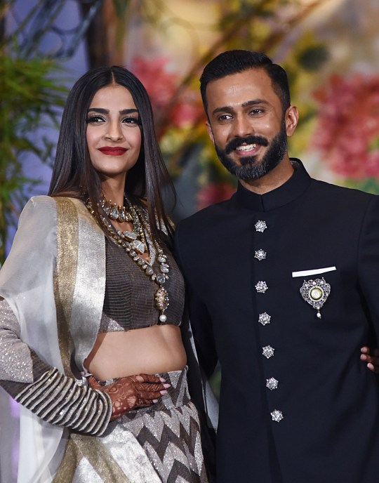 Indian Bollywood actress Sonam Kapoor poses with her husband, businessman Anand Ahuja after their traditional marriage ceremony in Mumbai late on May 8, 2018. / AFP PHOTO / Sujit JaiswalSUJIT JAISWAL/AFP/Getty Images