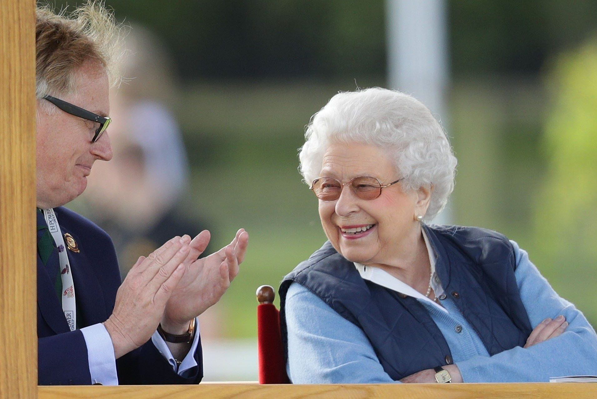 The Queen shares a joke as she enjoys some downtime at horse show