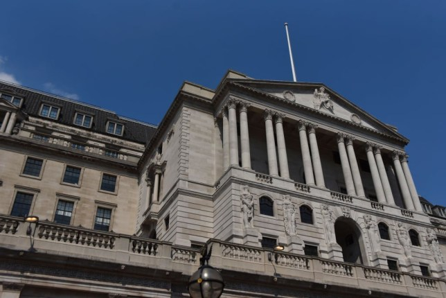 The Bank of England is pictured in the City of London as people enjoy lunch time in sunny weather outside the Royal Exchange, London on May 8, 2018. (Photo by Alberto Pezzali/NurPhoto via Getty Images)